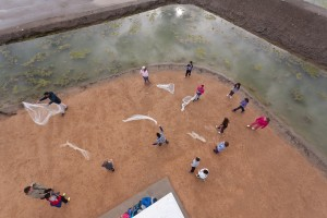 students practice with fishing nets