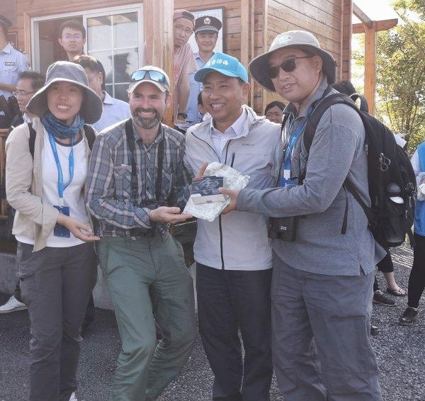 Happy birders accept an award in China