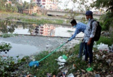 two men cleaning up