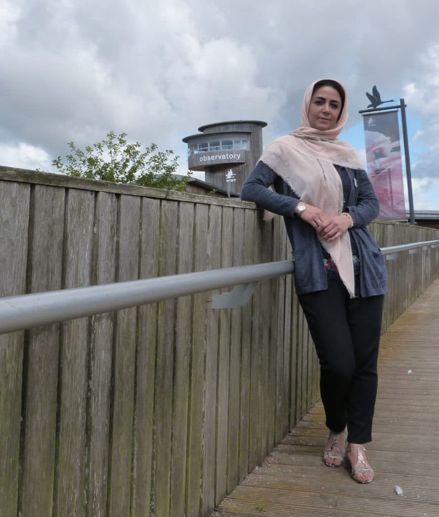 2019 intern Samaneh Azizi in front of Slimbridge Wetland Centre