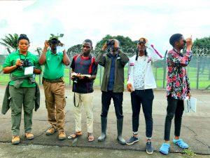 Six teen birders with binoculars