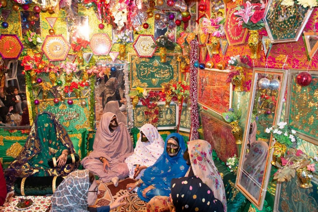 Women in colourful room