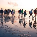 Guided group at sunrise on mudflat