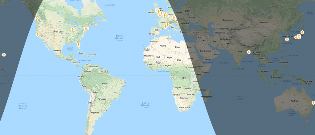 World map showing microphone icons