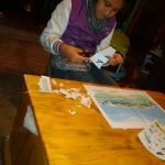 child cutting out wetland shapes