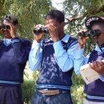 Three boys with binoculars