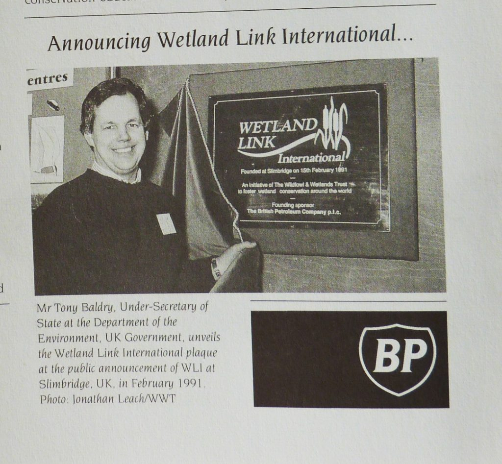 Smiling man launches WLI with a plaque