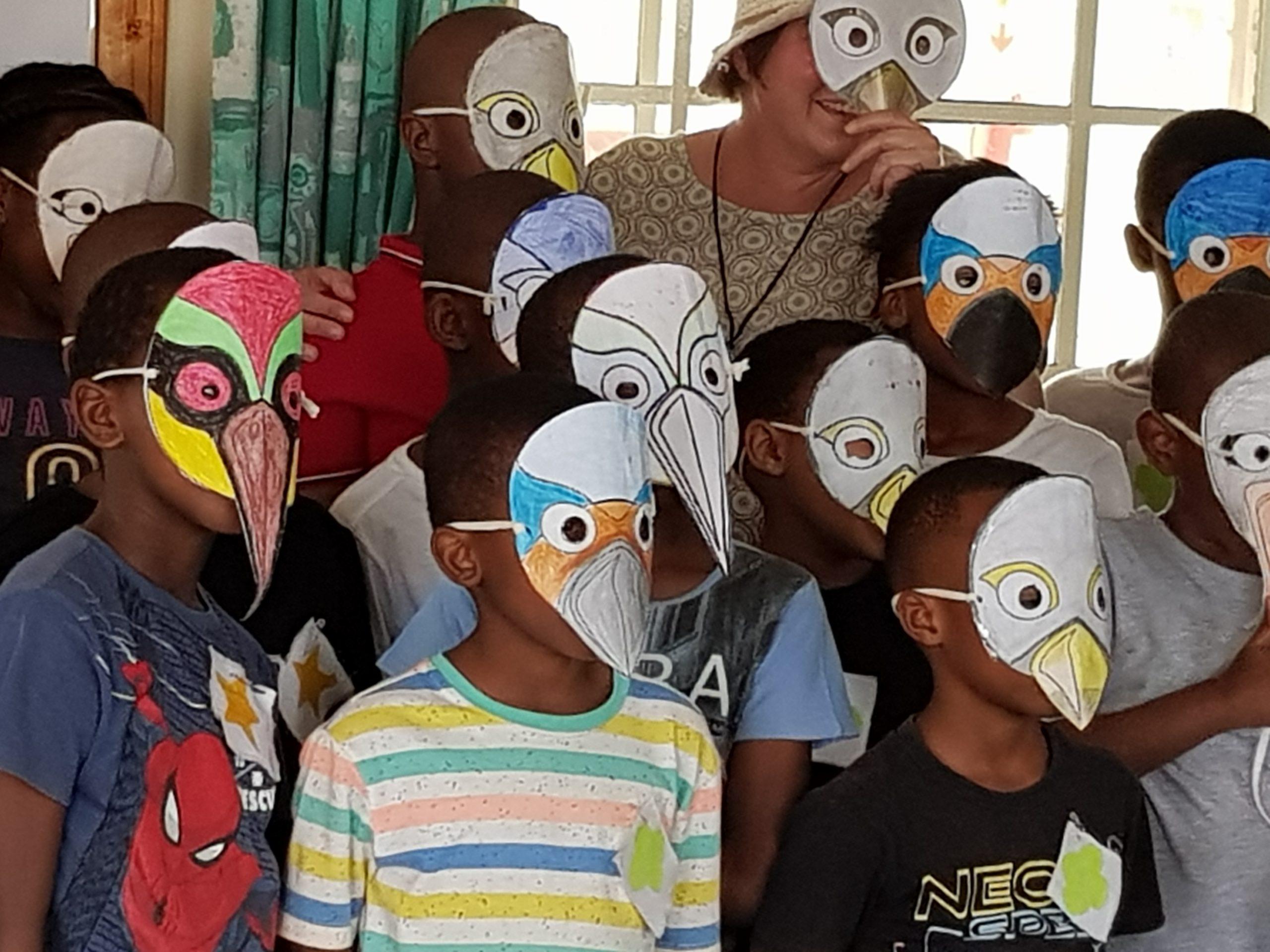 Children in paper bird masks