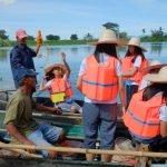 People in boat on wetland